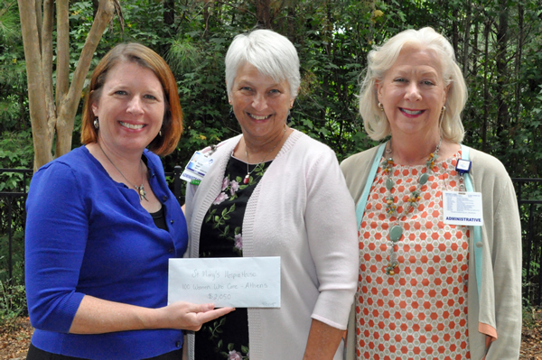 Delivering $2,050 to support St. Mary's Hospice House